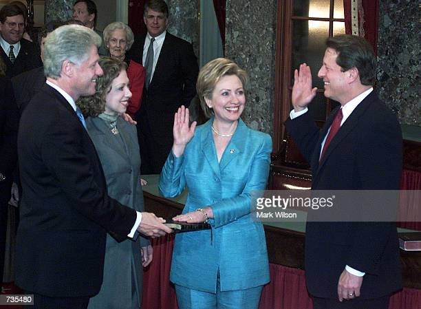 Vice President Al Gore swears in new US Senator Hillary Clinton January 3 2001 while her husband President Bill Clinton and daughter Chelsea look on...