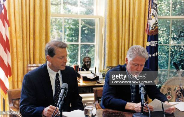 US Vice President Al Gore watches US President Bill Clinton as they jointly deliver a radio address from White House's Oval Office Washington DC...