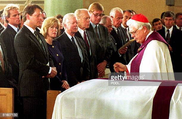 US Vice President Al Gore wife Tipper former presidents Jimmy Carter and Gerald Ford watch as Cardinal Bernard Law blesses the casket of former US...