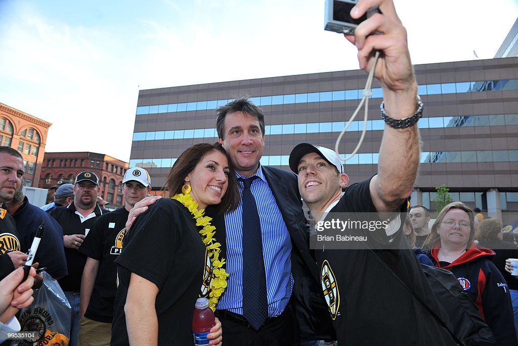 Vice President and Alumni player Cam Neely of the Boston Bruins poses with fans before Game Seven against the Philadelphia Flyers during the Eastern Conference Semifinals of the 2010 NHL Stanley Cup Playoffs at the TD Garden on May 14, 2010 in Boston, Massachusetts.