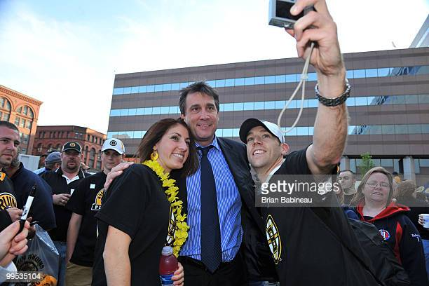 Vice President and Alumni player Cam Neely of the Boston Bruins poses with fans before Game Seven against the Philadelphia Flyers during the Eastern...