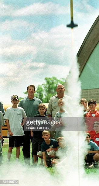 Vice President and Democratic presidential candidate Al Gore and Minnesota Governor Jesse Ventura watch a model rocket blast off with a group of...