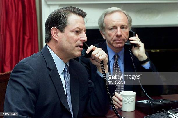 Vice President and Democratic presidential candidate Al Gore and vice presidential running mate Joe Lieberman hold a telephone conference call with...