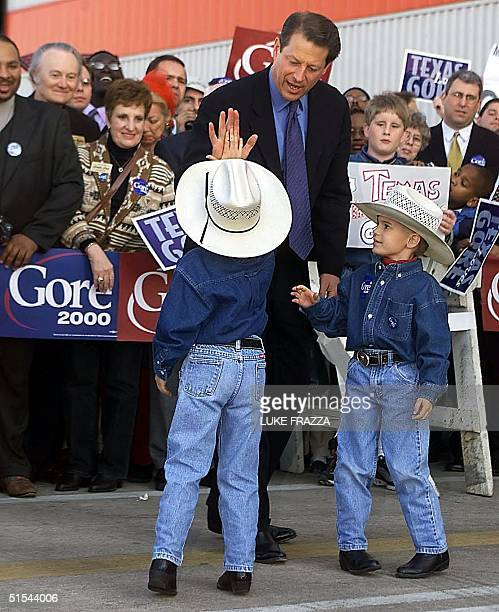 Vice President and Democratic presidential hopeful Al Gore greets supporters including brothers Dillon and Colin Craig upon Gore's arrival at Dallas...