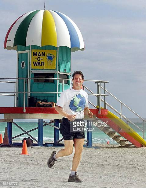 Vice President and Democratic presidential hopeful Al Gore jogs past a lifeguard stand on the beach In Miami Florida 13 March 2000 AFP PHOTO/Luke...