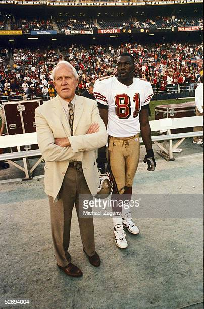 Vice President and General Manager Bill Walsh of the San Francisco 49ers stands on the sidelines with Terrell Owens during their game against the San...