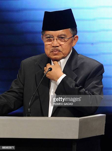 Vice President and Golkar Party leader Jusuf Kalla appears at the live televised debate between Indonesian President Susilo Bambang Yudhoyono and...