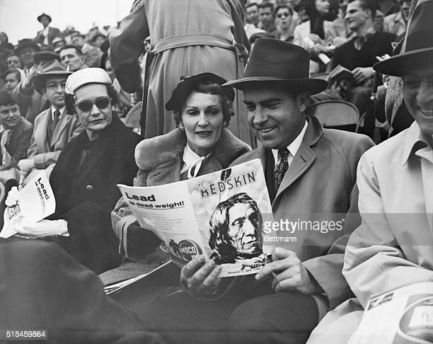 Vice President and Mrs Richard M Nixon were among the 30000 fans who watched the Washington Redskins play the New York Giants at Griffith Stadium...