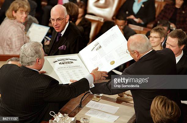 S Vice President and President of the Senate Dick Cheney hands the Electoral College ballot certificate from Ohio to Rep Robert Brady during the...