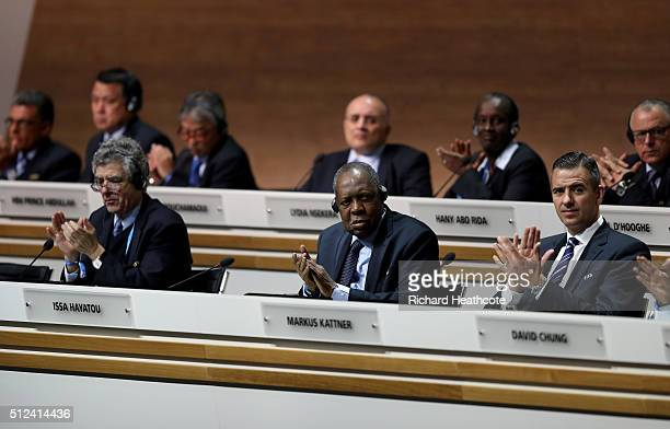Vice President Angel Maria Villar Llona FIFA Acting President Issa Hayatou and FIFA Acting Secretary General Markus Kattner applaud during the...