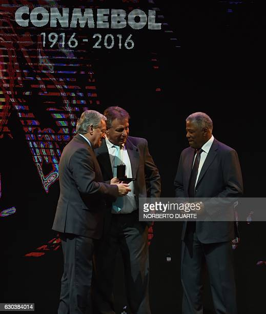 Vice President Arturo Sala greets Colombian Francisco Maturana and Ever Hugo Almeida declared distinguished coach during the Libertadores Cup draw in...