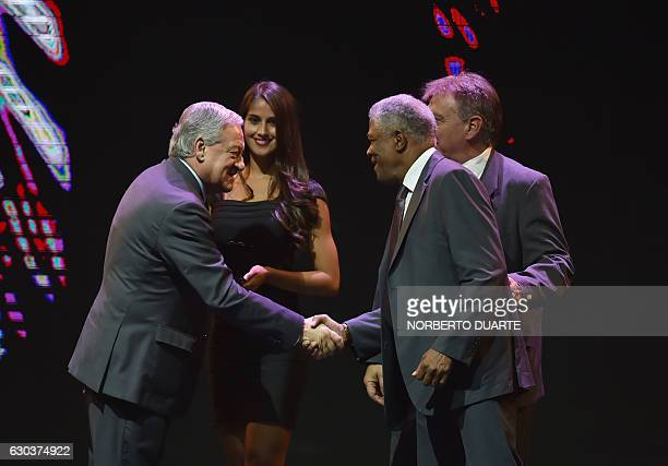Vice President Arturo Sala greets Colombian Francisco Maturana declared distinguished coach during the Libertadores Cup draw in Luque Paraguay on...