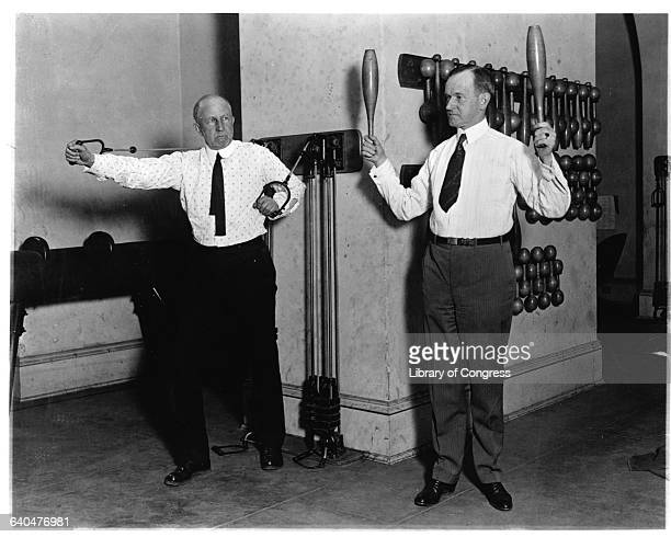Vice President Calvin Coolidge and Speaker of the House Fredrick Gillett exercise in the Congressional gym