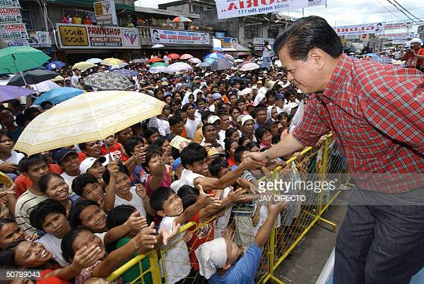 Vice President candidate Noli De Castro shakes hands with supporters at a campaign rally in Polangui town Albay south of Manila 04 May 2004 Some 43...