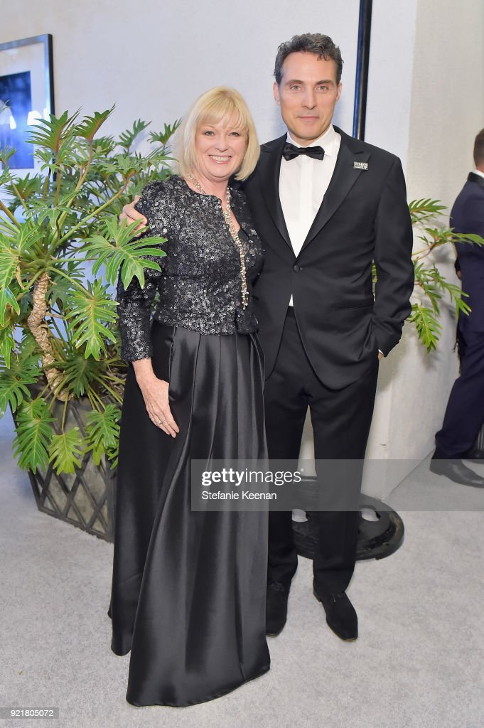 Vice President Catherine Adair (L) and actor Rufus Sewell attend the Costume Designers Guild Awards at The Beverly Hilton Hotel on February 20, 2018 in Beverly Hills, California.