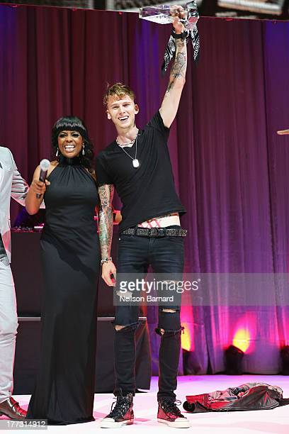 Vice President Catherine Brewton and Machine Gun Kelly speak onstage at the 2013 BMI RB/HipHop Awards at Hammerstein Ballroom on August 22 2013 in...