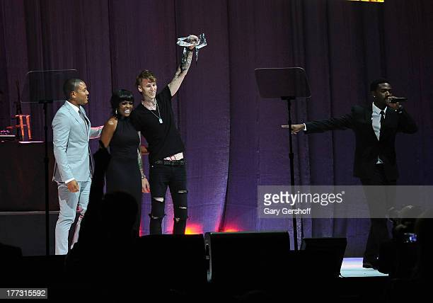 Vice President Catherine Brewton Machine Gun Kelly and Ray J onstage at the 2013 BMI RB/HipHop Awards at Hammerstein Ballroom on August 22 2013 in...
