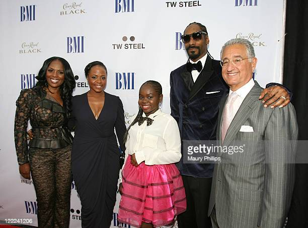 BMI Vice President Catherine Brewton Shante Broadus Cori Broadus rapper Snoop Dogg and BMI President and CEO Del Bryant arrive at the 11th Annual BMI...
