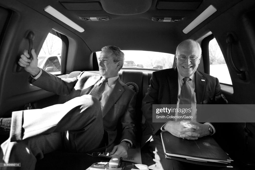 Vice President Cheney and President George W Bush riding in back of a limousine smiling, Washington DC, Washington, USA, February 28, 2008.