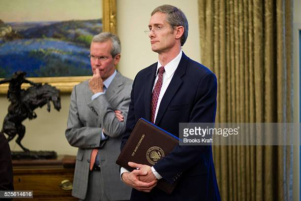 Vice President Cheney's National Security Advisor John Hannah holds a top secret folder during a meeting in the Oval Office at the White House in...