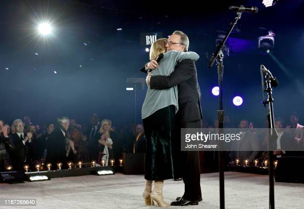 Vice President Creative Jody Williams and Karen Williams embrace onstage as BMI presents Dwight Yoakam with President's Award at 67th Annual Country...
