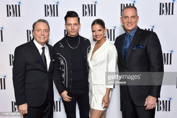 BMI Vice President Creative Jody Williams Devin Dawson Leah Sykes and BMI President/CEO Mike O'Neill attend as BMI presents Dwight Yoakam with...