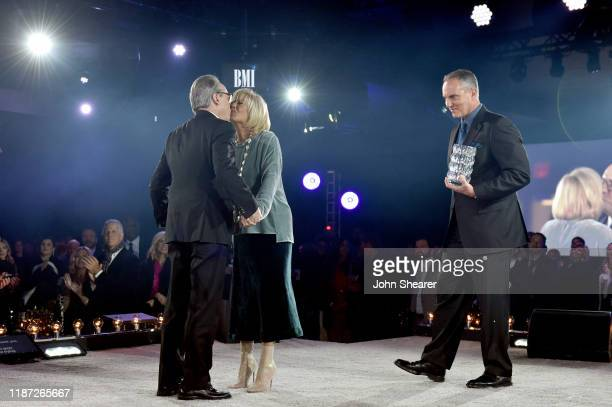 BMI Vice President Creative Jody Williams Karen Williams and BMI President/CEO Mike O'Neill speak onstage as BMI presents Dwight Yoakam with...