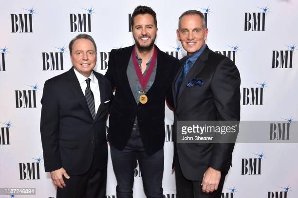 BMI Vice President Creative Jody Williams Luke Bryan and BMI President/CEO Mike O'Neill attend as BMI presents Dwight Yoakam with President's Award...