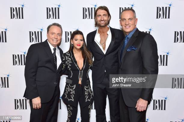 BMI Vice President Creative Jody Williams Maren Morris Ryan Hurd and BMI President/CEO Mike O'Neill attend as BMI presents Dwight Yoakam with...