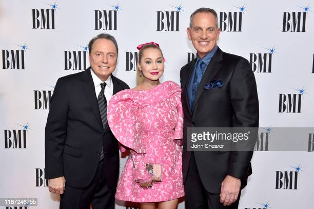 BMI Vice President Creative Jody Williams RaeLynn and BMI President/CEO Mike O'Neill attend as BMI presents Dwight Yoakam with President's Award at...