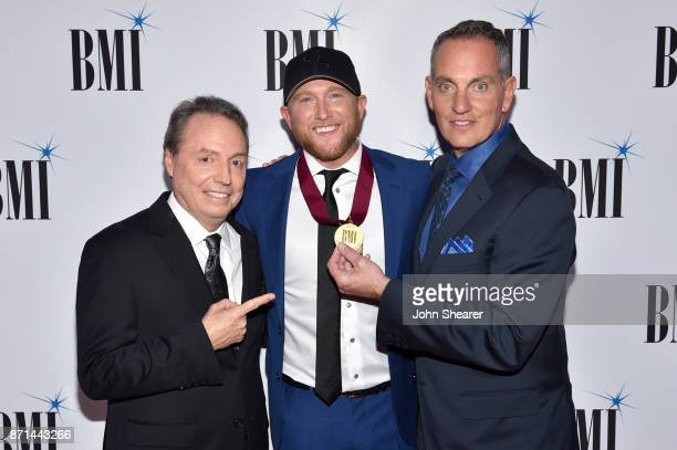 Vice President Creative Nashville Jody Williams singersongwriter Cole Swindell and BMI President CEO Mike O'Neill attend the 65th Annual BMI Country...