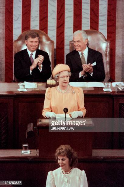 Vice President Dan Quayle and Speaker of the United States House of Representatives Thomas Foley applaud as Britain's Queen Elizabeth II adresses a...