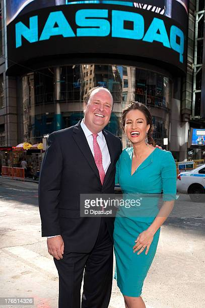 NASDAQ vice president David Wicks and Baby Quest Foundation spokeswoman America Olivo ring the opening bell at the NASDAQ MarketSite on August 14...