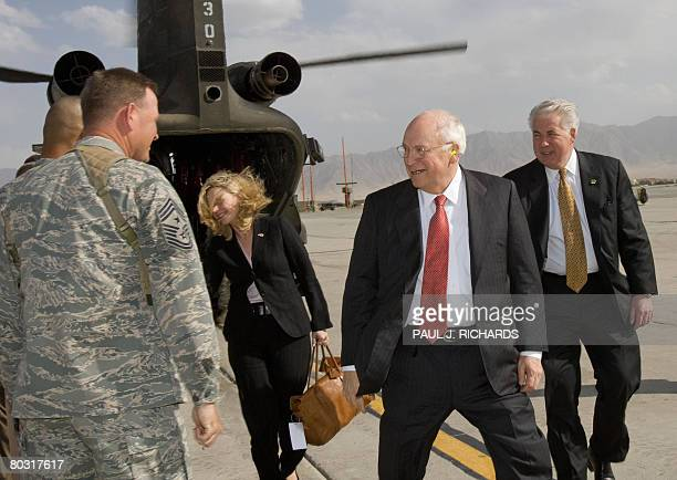 US Vice President Dick Cheney arrives along with his daughter Liz on an unannounced visit to Bagram Air Field in Afghanistan on March 20 for...