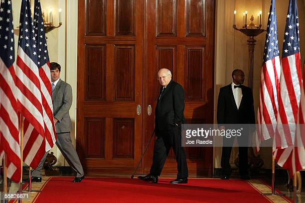 S Vice President Dick Cheney arrives for a ceremony to watch John Roberts being sworn in as the new Chief Justice of the US in the East Room at the...
