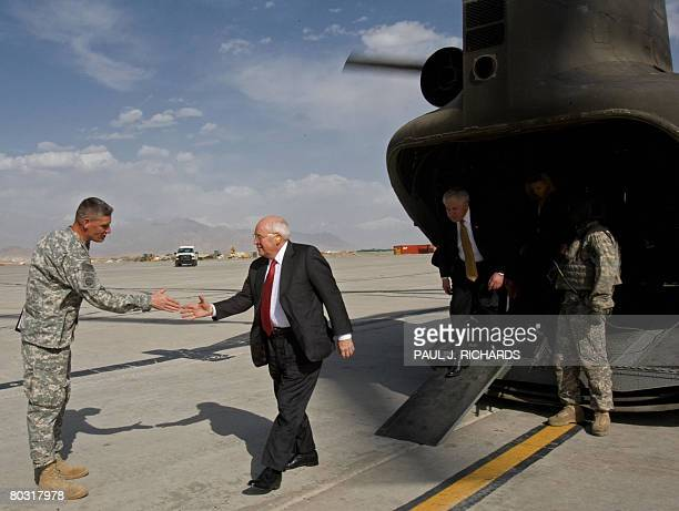 US Vice President Dick Cheney arrives on an unannounced visit to Bagram Air Field in Afghanistan and is greeted by US Army Major General David M...