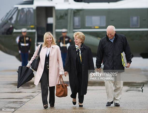 US Vice President Dick Cheney daughter Liz and wife Lynne walk to Air Force 2 at Andrews Air Force Base as they depart on a tenday trip to the Middle...