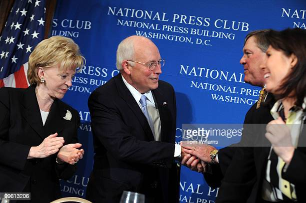 Vice President Dick Cheney greets Jack Ford chairman of the Gerald Ford Foundation and son of the late President after a journalism awards ceremony...