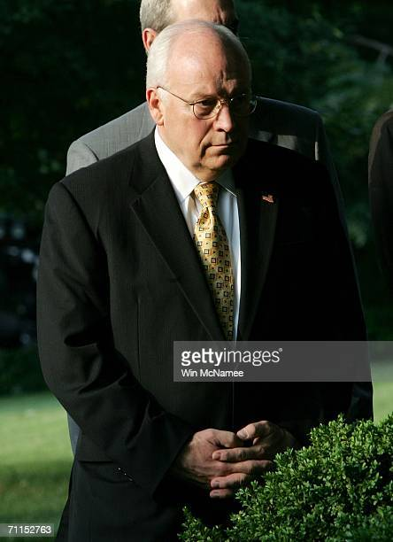 S Vice President Dick Cheney listens as US President George W Bush speaks in the Rose Garden about the death of Abu Musab alZarqawi June 7 2006 in...