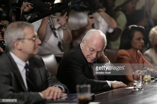 Vice President Dick Cheney listens as US President George W Bush speaks on the growing crisis in the Middle East while meeting with bipartisan...