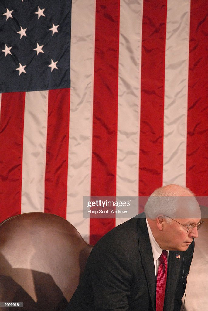 Vice President Dick Cheney listens to Nuri al-Maliki, Prime Minister of Iraq, deliver a speech to a joint session of Congress.