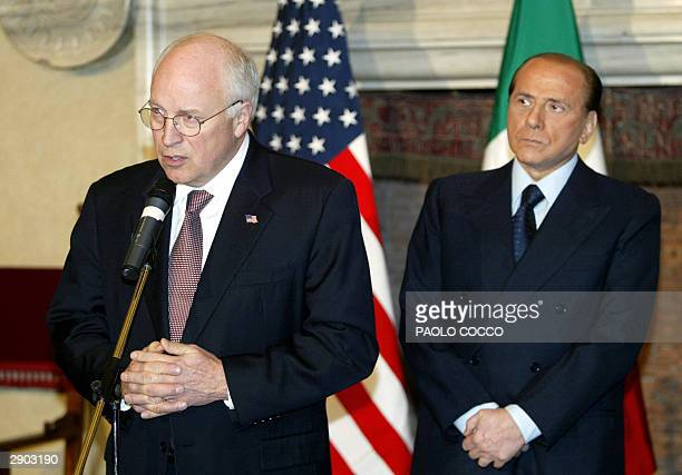 Vice President Dick Cheney makes a speech flanked by Italian Prime Minister Silvio Berlusconi at Rome's Villa Madama 26 January 2004 Cheney called...