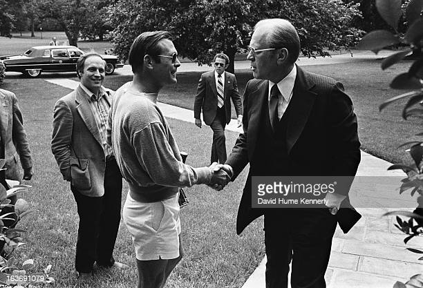 Vice President Dick Cheney photographed from 1975 to 2006 in Washington DC Donald Rumsfeld in shorts shaking President Ford's hand as Dick Cheney...