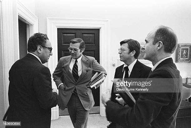 Vice President Dick Cheney photographed from 1975 to 2006 in Washington DC Pictured lr Henry Kissinger Donald Rumsfeld unknown and Brent Scowcroft