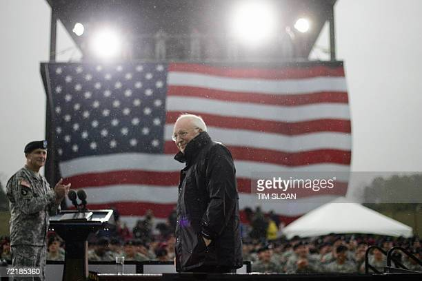Vice President Dick Cheney receives applause from Major Thomas Turner and 4,000 members of the 101st Airborne Division after making remarks at a...