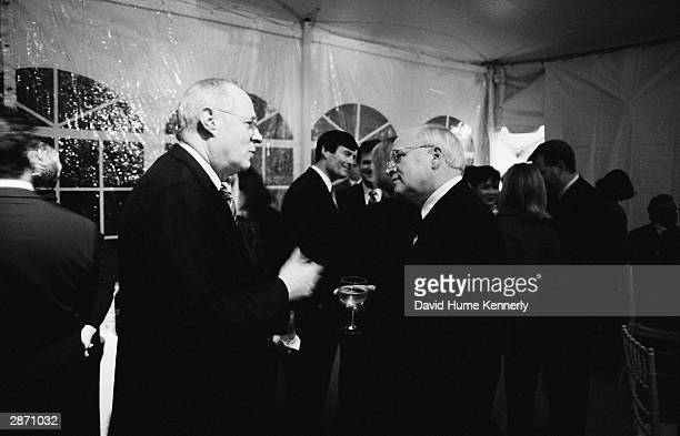 US Vice President Dick Cheney speaks with Supreme Court Justice Anthony Kennedy at the Vice President's Christmas Party December 12 2001 Washington DC
