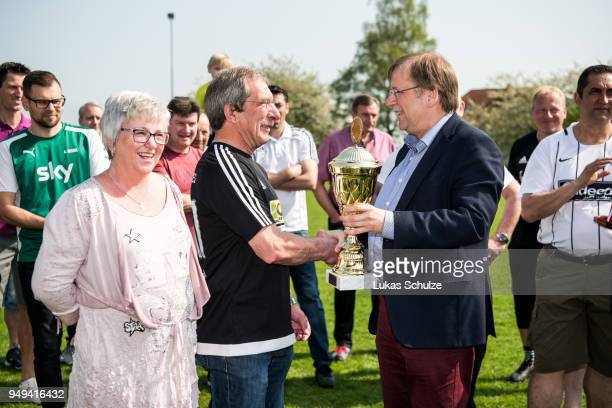 Vice President Dr Rainer Koch honors amateur Of the Year Hanno Makel on April 21 2018 in Weilburg Germany