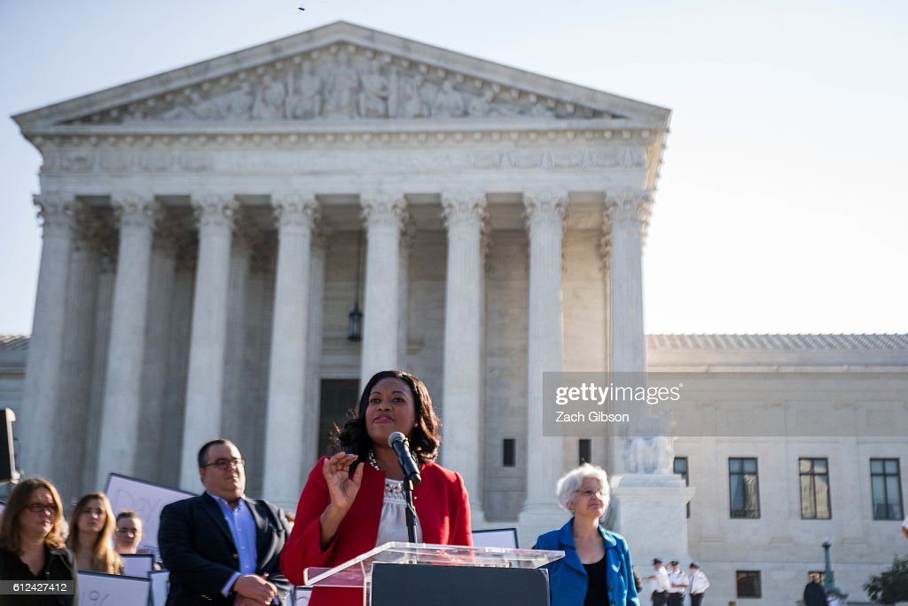 Vice President for Legal Progress at the Center for Americana Progress Michele Jawando speaks during a rally urging the U.S. Senate to hold a confirmation vote for Supreme Court Nominee Merrick Garland outside of The Supreme Court of the United States on October 4, 2016 in Washington, DC. Today marks the 202nd day since President Barack Obama nominated Judge Garland to fill the vacancy left after former Justice Antonin Scalia passed away in February.