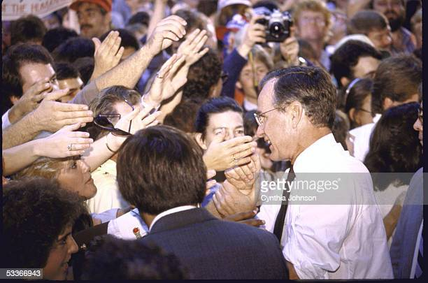Vice President George Bush on the campaign trail surounded by crowd of supporters at Western Kentucky University