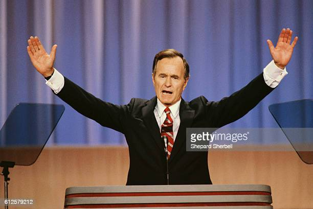 Vice President George Bush raises his arms during a speech at the 1988 Republican National Convention in New Orleans Louisiana